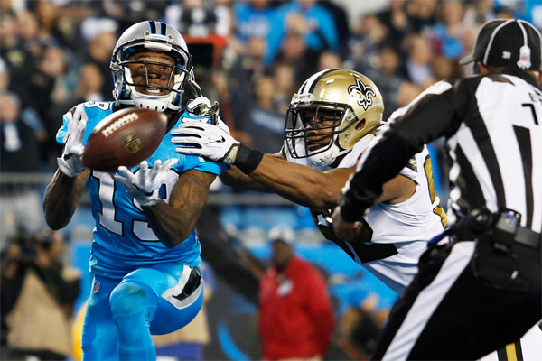 Ted Ginn Jr bat Craig Robertson pour le TD de 40 yards